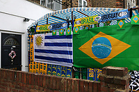 Market traders set up for business close to the ground selling scarves, hats and merchandise during Brazil vs Uruguay, International Friendly Match Football at the Emirates Stadium on 16th November 2018