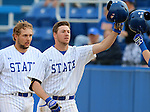 BROOKINGS, SD - APRIL 1:  Matt Johnson from South Dakota State gets a high five after a three run home run against Dakota Wesleyan during their home opener Wednesday afternoon in Brookings. (Photo by Dave Eggen/Inertia)