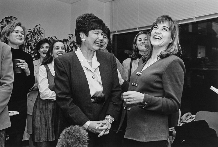 Rep. Anita Perez Ferguson, D-Calif., Director of National Women in Politics Caucus, laughs with Rep. Loretta Sanchez, D-Calif., at a reception, Nov. 21, 1996. (Photo by Laura Patterson/CQ Roll Call via Getty Images)