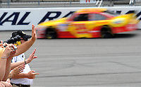 May 1, 2009; Richmond, VA, USA; Fans wave as NASCAR Sprint Cup Series driver Kevin Harvick races by during practice for the Russ Friedman 400 at the Richmond International Raceway. Mandatory Credit: Mark J. Rebilas-