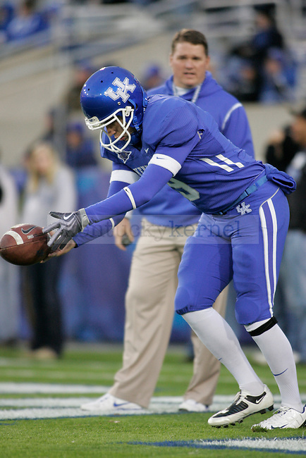UK punter Ryan Tydlacka warms up before the game against Mississippi State at Commonwealth Stadium on Saturday, Oct. 31, 2009. Photo by Adam Wolffbrandt | Staff