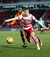 Doncaster Rovers' Tommy Rowe (R) shields the ball from Oldham Athletic's Ousmane Fane (L) during the Sky Bet League 1 match between Doncaster Rovers and Oldham Athletic at the Keepmoat Stadium, Doncaster, England on 16 December 2017. Photo by Juel Miah / PRiME Media Images.