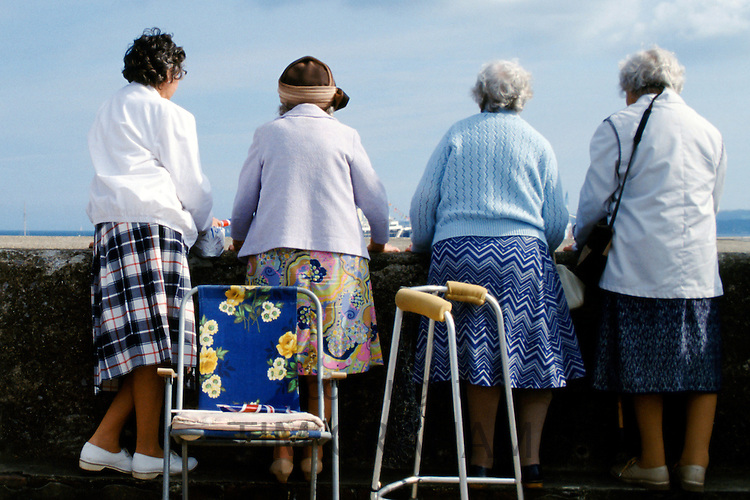 Pensioners enjoying the view at the English seaside, UK