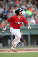 Catcher Alan Marrero (16) of the Greenville Drive runs out a batted ball in a game against the Rome Braves on Friday, June 28, 2019, at Fluor Field at the West End in Greenville, South Carolina. Rome won, 4-3. (Tom Priddy/Four Seam Images)