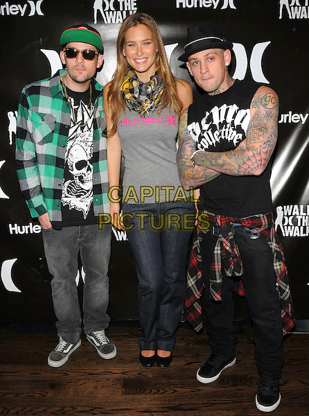 JOEL MADDEN, BAR REFAELI & BENJI MADDEN (judges).The runway competition Walk the Walk hosted by Hurley held at House of Blues Anaheim in Anaheim, California, USA. February 24th, 2009                                                                                      full length grey gray top hat tattoos green sunglasses shades arms crossed twins brothers siblings  .CAP/DVS.©Debbie VanStory/Capital Pictures.