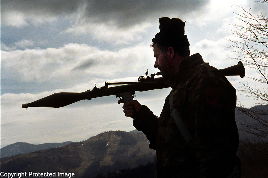 Macedonia.2001..a member of the Macedonian National Liberation Army, a rebel Albanian army that emerged and began a conflict with the Macedonian Army and Police, allegedly in order to fight for the rights of the Albanian minority in Macedonia.