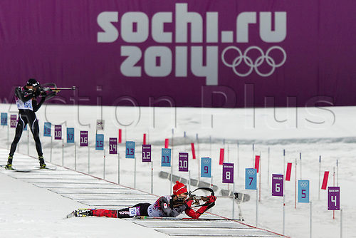 08.02.14 Sochi, Krasnodar Krai, Russia.  Scott PERRAS (CAN) shoots prone during the Men's Biathlon 10km Sprint  at the Laura Cross-Country Ski & Biathlon Centre - XXII Olympic Winter Games