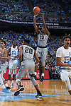 Bryant Crawford (13) of the Wake Forest Demon Deacons fires up a jump shot during first half action against the North Carolina Tar Heels at the Dean Smith Center on December 30, 2017 in Chapel Hill, North Carolina.  The Tar Heels defeated the Demon Deacons 73-69.  (Brian Westerholt/Sports On Film)