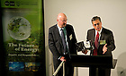 August 30, 2012; Peter Kilpatrick, Dean of Engineering, presents a Notre Dame football with Fr. John Jenkins' signature to Mark Ferguson, Director General Science Foundation of Ireland who gave the closing remarks during The Future of Energy Academic Program at the Science Gallery in Dublin, Ireland.  Photo by Barbara Johnston/University of Notre Dame