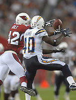 Aug 25, 2007; Glendale, AZ, USA; San Diego Chargers wide receiver Legedu Naanee (40) battles Arizona Cardinals safety Terrence Holt (42) for the ball at University of Phoenix Stadium. San Diego defeated Arizona 33-31. Mandatory Credit: Mark J. Rebilas-US PRESSWIRE
