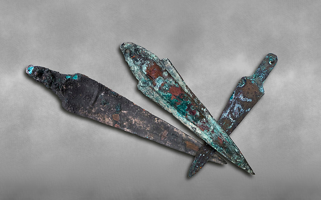 Hittite bronze spear heads. Hittite Period 1650 - 1450 BC.  Hattusa Boğazkale. Çorum Archaeological Museum, Corum, Turkey. Against a grey bacground.