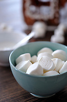 A bowl of squashy marshmallows awaiting the moment when they are stuck to the Christmas gingerbread house