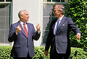 United States President George H.W. Bush, right, in conversation with President Mikhail Gorbachev of the Union of Soviet Socialist Republics, left, as they walk to Gorbachev's car following a state arrival ceremony on the South Lawn of the White House in Washington, DC on Thursday, May 31, 1990.  It was the start of three days of talks between the two leaders.<br /> Credit: Ron Sachs / CNP