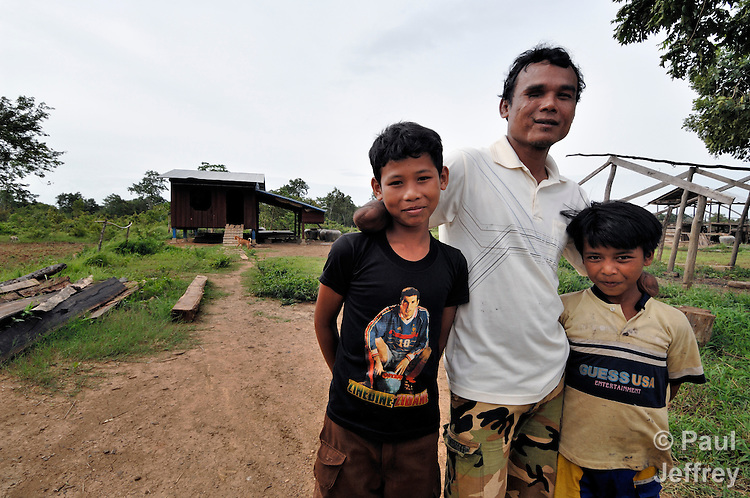 Millions of landmines have yet to be cleared in Cambodia, and farmers have to wrestle with the consequences every day. In the village of Dey Sor, 39-year old Mom Noeum, who lost both his arms and one eye in 1996 while serving as a government soldier fighting the Khmer Rouge. He has three children, two of whom accompany him here.