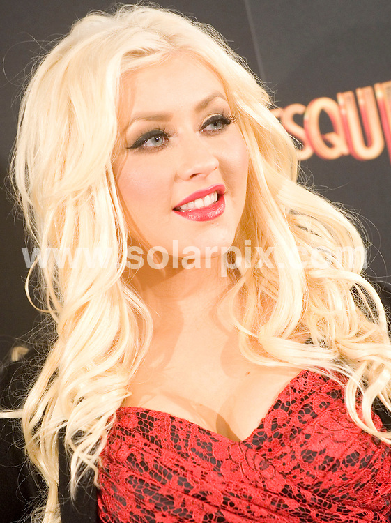 "**ALL ROUND PICTURES FROM SOLARPIX.COM**                                             **WORLDWIDE SYNDICATION RIGHTS EXCEPT SPAIN & SOUTH AMERICA - NO SYNDICATION IN SPAIN OR SOUTH AMERICA**                                                                                  Stars in Madrid for the photocall for the new film,  ""Burlesque""                                                                            This pic:    Christina Aguilera                                                                                       JOB REF:   12589     MPA       DATE:   10.12.10                                                         **MUST CREDIT SOLARPIX.COM OR DOUBLE FEE WILL BE CHARGED**                                                                      **MUST AGREE FEE BEFORE ONLINE USAGE**                               **CALL US ON: +34 952 811 768 or LOW RATE FROM UK 0844 617 7637**"