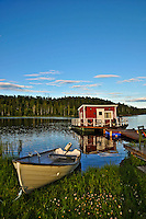Floating stuga (cottage) and rowboat in Northern Sweden