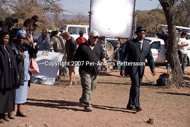 GABORONE, BOTSWANA - AUGUST 18: Anthony Minghella (c), the Oscar-winning director, instructs actors before a funeral scene on the set of The No 1 Ladies Detective Agency on August 18, 2007 in Gaborone, Botswana. The film is based on Alexander McCall Smith?s best-selling series. Mr. Minghella and his crew filmed for months around Botswana and the Government of Botswana has invested $US5 Million in the project. (Photo by Per-Anders Pettersson/Getty Images)...