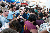 The crowd forms a moshpit at the 4 Knots Festival at South Street Seaport in New York City on July 12, 2014.