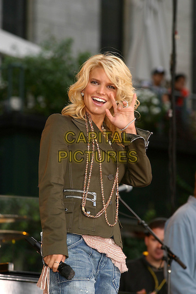 JESSICA SIMPSON.Performs on Good Morning America's Summer Concert Series, Bryant Park, New York City, New York .August 6, 2004 .half length, singing, stage, concert, gig, brown zipper, scarf, beads, necklace, khaki, waving, gesture.www.capitalpictures.com.sales@capitalpictures.com.©Capital Pictures