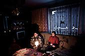 Kotowice 01.2010 Poland<br /> Kotowice were among the first places where blackouts - 12 days ago. Mother and daughter sitting at a candle in the absence of electricity.<br /> Three atmospheric forces: rain, snow and frost have changed into an ecological disaster the Myszkowski district in the Czestochowskie province, located 230 kilometers south of Warsaw. Almost 95% of all trees are down.Thousands of homes are left without electricity.<br /> Photo: Adam Lach / Napo Images for Newsweek Polska<br /> <br /> Kotowice byly jednym z pierwszych miejsc gdzie zabraklo pradu - 12 dni temu. Matka z corka siedzia przy swiecy z powodu braku pradu.<br /> Wstepnie &quot;tylko&quot; 95% scietych drzew w dwoch powiatach. 0.5 miliona metrow szesciennych zniszczonych lasow..Tysiace gospodarstw bez pradu. Wszyscy maja swiadomosc, ze na kumulacje trzech niekorzystnych .zjawisk atmosferycznych rady nie ma.Trzy zjawiska kt&oacute;re zamienily jeden z obszarow Polski w istna katastrofe ekologiczna: deszcz, snieg i szadz.<br /> Fot: Adam Lach / Napo Images dla Newsweek Polska
