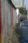 A cyclist rides by one of the last remaining sections of the Cold War barrier still visible in the city. This section, around one kilometre in length, was turned into an alfresco exhibition space in 1990 called the East Side Gallery and runs by the river Spree at Warschauer Strasse. The Wall was opened 15 years ago on 9th November 1989.