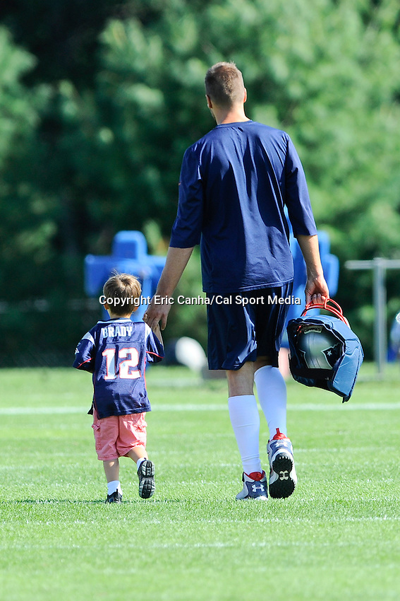 August 15, 2013 - Foxborough, Massachusetts, U.S. - New England Patriots quarterback Tom Brady (12) walks with his son Benjamin at the end of the New England Patriots training camp at Gillette Stadium in Foxborough Massachusetts.   Eric Canha/CSM