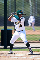 Oakland Athletics first baseman Alonzo Medina (15) at bat during an Instructional League game against the Cincinnati Reds on September 29, 2017 at Lew Wolff Training Complex in Mesa, Arizona. (Zachary Lucy/Four Seam Images)