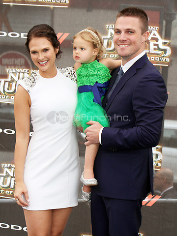 NEW YORK, NY-May 22:  Cassandra Jean, Mavi Amell, Stephen Amell at Paramount Pictures, Nickelodeon Movies and Dodge present the WORLD premiere of TEENAGE MUTANT NINJA TURTLES: OUT OF THE SHADOWS! at Madison Square Garden New York. NY May 22, 2016. Credit:RW/MediaPunch