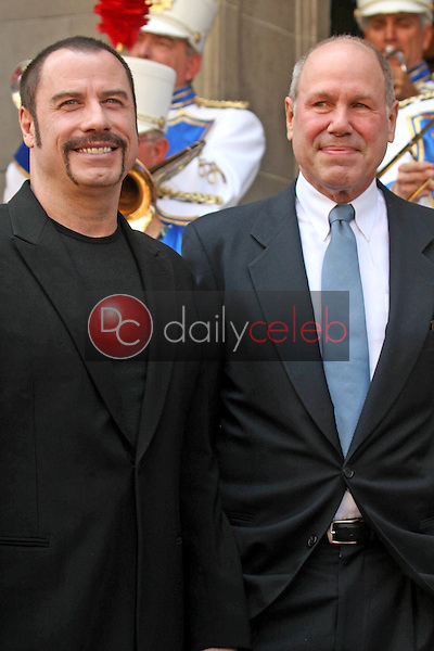 John Travolta and Michael D. Eisner<br />