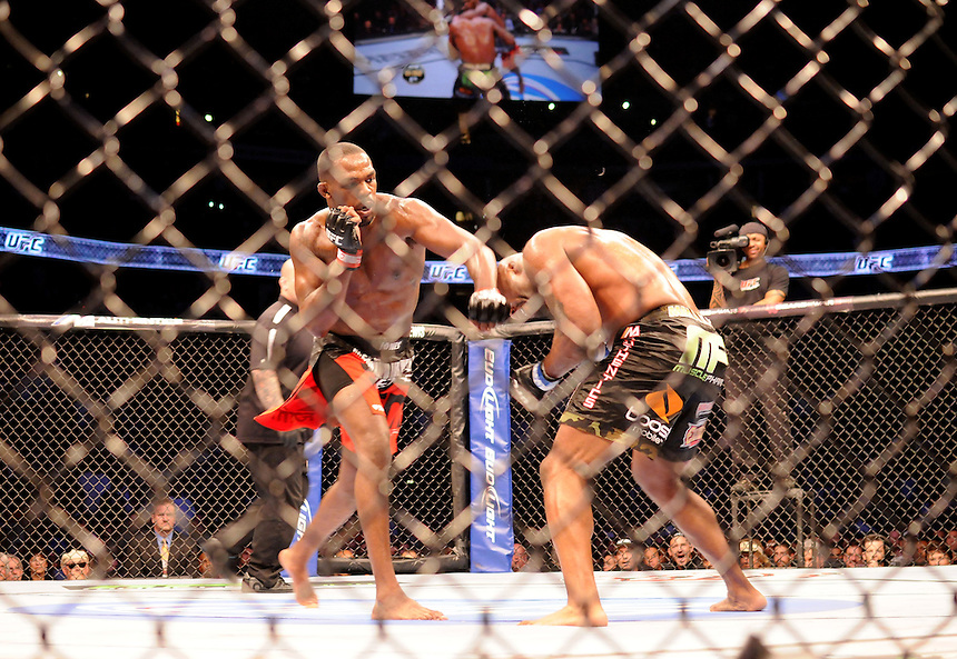 """24 SEPTEMBER 2011:  Jon """"Bones"""" Jones lands a punch to the head of Quinton """"Rampage"""" Jackson   during UFC 135 at the Pepsi Center in Denver, Colorado. *****For Editorial Use Only*****"""