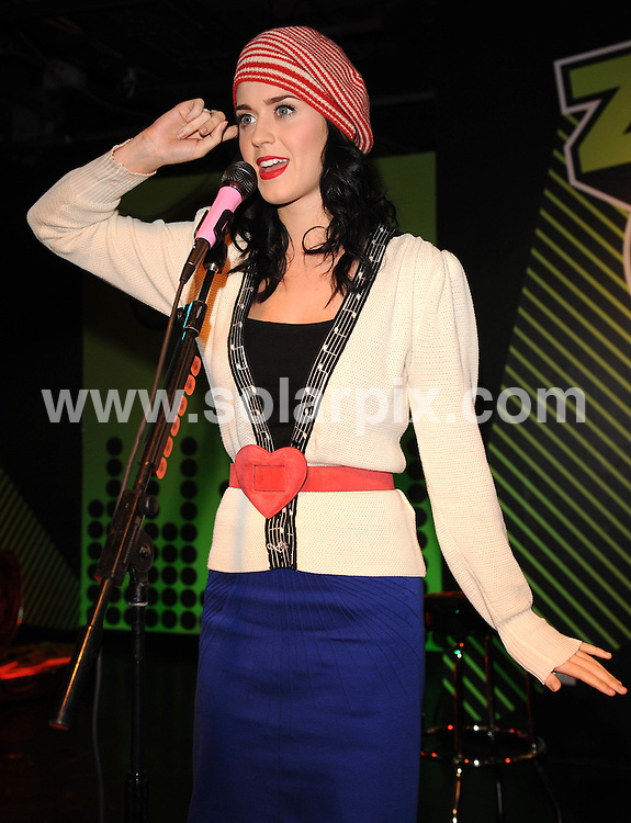 **ALL ROUND PICTURES FROM SOLARPIX.COM**.**WORLDWIDE SYNDICATION RIGHTS**.The pop singer Katy Perry performs live for fans at Zavvi, Oxford Street in London.  ..JOB REF:7668- SSD     DATE:12-11-08.**MUST CREDIT SOLARPIX.COM OR DOUBLE FEE WILL BE CHARGED* *UNDER NO CIRCUMSTANCES IS THIS IMAGE TO BE REPRODUCED FOR ANY ONLINE EDITION WITHOUT PRIOR PERMISSION*