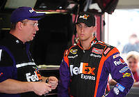Feb 9, 2008; Daytona, FL, USA; Nascar Sprint Cup Series driver Denny Hamlin (right) talks with crew chief Mike Ford during practice for the Daytona 500 at Daytona International Speedway. Mandatory Credit: Mark J. Rebilas-US PRESSWIRE