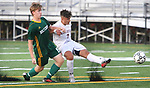 WATERBURY  CT. - 14 October 2019-101419SV11- #7 Lucas Silva of Naugatuck High takes a shot on goal past #15 Colin Harrigan of Holy Cross High during NVL Soccer action in Waterbury Monday. <br />Steven Valenti Republican-American