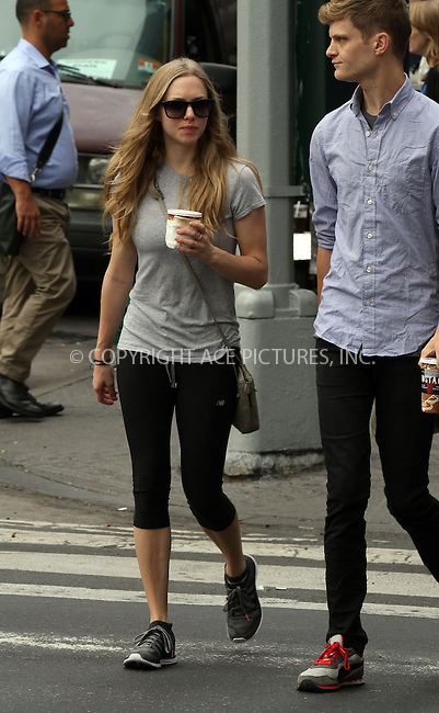 WWW.ACEPIXS.COM<br /> <br /> September 10 2013, New York City<br /> <br /> Actress Amanda Seyfried walks with friends in her East Village neighborhood on September 10 2013 in New York City<br /> <br /> By Line: Zelig Shaul/ACE Pictures<br /> <br /> <br /> ACE Pictures, Inc.<br /> tel: 646 769 0430<br /> Email: info@acepixs.com<br /> www.acepixs.com
