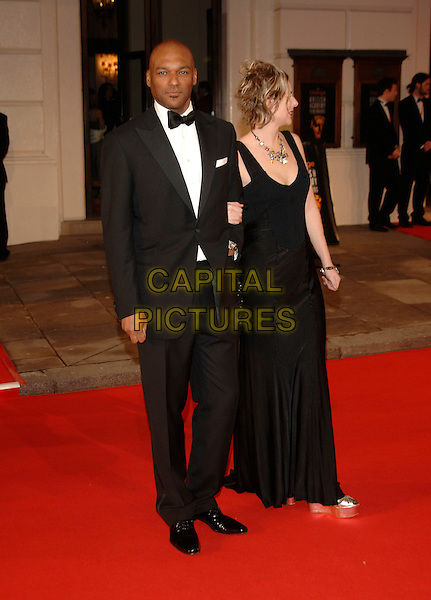 COLIN SALMON & FIONA HAWTHORNE.Red Carpet Arrivals at The Orange British Academy Film Awards (BAFTA's) held at the Royal Opera House, Covent Garden, London, England, February 11th 2007..full length black dress .CAP/PL.©Phil Loftus/Capital Pictures