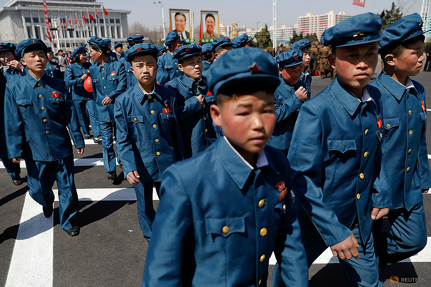 Men wearing uniforms check newly constructed residential complex after its opening ceremony in Ryomyong street in Pyongyang, North Korea April 13, 2017.  REUTERS/Damir Sagolj