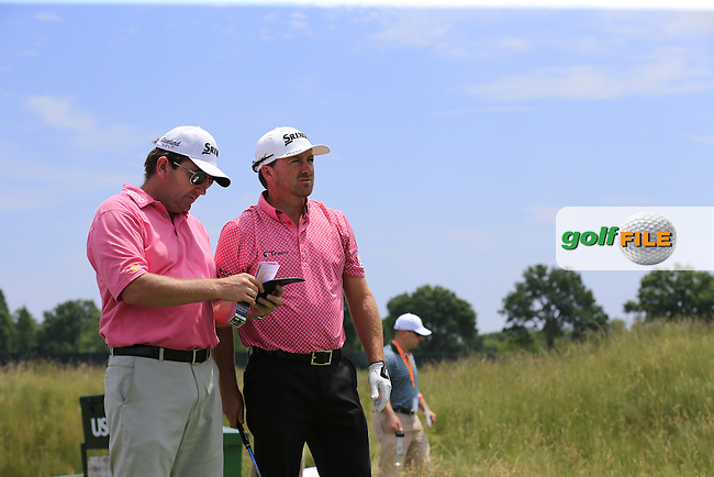 Graeme McDowell (NIR) and caddy Ken Comboy on the 11th tee during Wednesday's Practice Day of the 2016 U.S. Open Championship held at Oakmont Country Club, Oakmont, Pittsburgh, Pennsylvania, United States of America. 15th June 2016.<br /> Picture: Eoin Clarke | Golffile<br /> <br /> <br /> All photos usage must carry mandatory copyright credit (&copy; Golffile | Eoin Clarke)