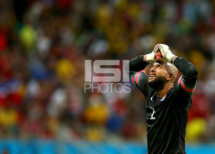 USA goalkeeper Tim Howard shows a look of dejection after a missed chance to make the score 2-2