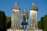 Statues depicting Christopher Columbus talking with King Ferdinand II of Aragon, in the gardens of the Alcazar de Cordoba, Cordoba, Andalusia, Spain.