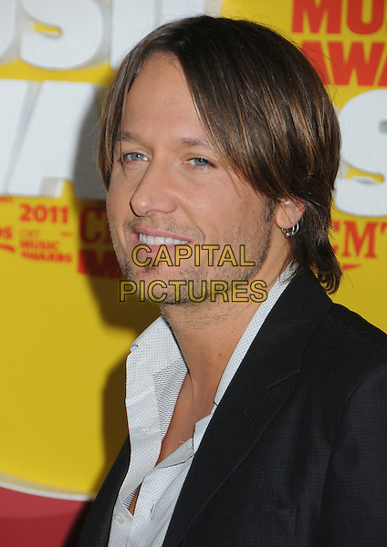 Keith Urban.2011 CMT Music Awards held at Bridgestone Arena, Nashville, Tennessee, USA, 8th June 2011..country arrivals portrait headshot smiling soul patch facial hair white shirt grey gray stubble .CAP/ADM/LF.©Laura Farr/AdMedia/Capital Pictures.