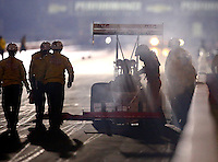 Sep 5, 2015; Clermont, IN, USA; NHRA top fuel driver T.J. Zizzo stands alongside his car as the safety safari rescue crews arrive on the scene after an engine explosion and fire during qualifying for the US Nationals at Lucas Oil Raceway. Mandatory Credit: Mark J. Rebilas-USA TODAY Sports