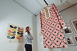 "Pictured: Exhibition visitor Sarah Bull admires one of the giant dresses on display at the Orla Kiely exhibition which features a design titled Velvet Spot Flower.<br /> <br /> An exhibition of fashion and textile pieces by OBE awarded designer Orla Kiely is currently on display at the Winchester Discovery Centre in Hampshire.  <br /> <br /> ""Orla Kiely: A Life in Pattern"" features unique and colourful clothing alongside giant hanging dresses, all emblazoned with unique and iconic patterns created by the world renowned designer.<br /> <br /> The main attraction of the show is a feature wall displaying 100 handbags designed owned and sold by Orla Kiely.  The handbags feature a wide range of designs including her iconic ""Stem"" design.   <br /> <br /> The show continues until January 5th, 2020. <br /> <br /> © Morten Watkins/Solent News & Photo Agency<br /> UK +44 (0) 2380 458800"