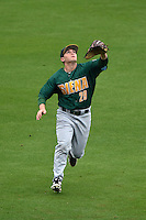 Siena Saints outfielder Carlos Tapia (29) tracks a fly ball, which would drop in for an error, during the second game of a doubleheader against the Michigan Wolverines on February 27, 2015 at Tradition Field in St. Lucie, Florida.  Michigan defeated Siena 6-0.  (Mike Janes/Four Seam Images)