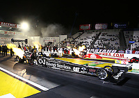 Feb 7, 2014; Pomona, CA, USA; NHRA top fuel dragster driver Bob Vandergriff Jr (near lane) races alongside Doug Kalitta during qualifying for the Winternationals at Auto Club Raceway at Pomona. Mandatory Credit: Mark J. Rebilas-