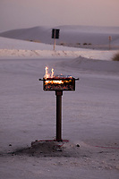 Food cooks on a grill in a parking area as the sun sets at White Sands National Monument near Alamogordo, New Mexico, USA, on Sat., Dec. 30, 2017.