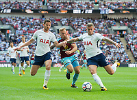 Tottenham's Toby Alderweireld ; Jan Vertonghen and and Burnley Scott Arfield during the Premier League match between Tottenham Hotspur and Burnley at White Hart Lane, London, England on 27 August 2017. Photo by Andrew Aleksiejczuk / PRiME Media Images.