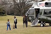 Washington, DC - March 8, 2009 -- United States President Barck Obama returns from Camp David aboard Marine One with First Lady Michelle and his daughters Sasha and Malia (in front on left) on the South Lawn of the White House, Washington D.C, on 08 March 2009.  .Credit: Chris Usher - Pool via CNP