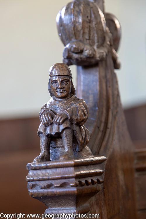 Village parish church of Saint Margaret, Linstead Parva, Suffolk, England, UK 15th century wooden carved pew end figure