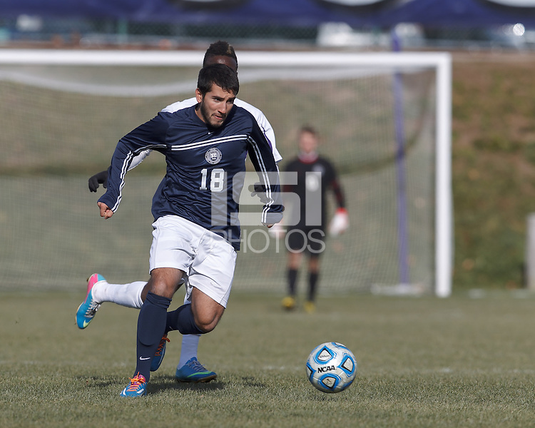 Brandeis midfielder Foti Andreo (18) brings the ball forward.  NCAA Division III Sectionals. Williams College (white) defeated Brandeis University (blue/white), 2-0, on Hitchcock Field at Amherst College on November 23, 2013.