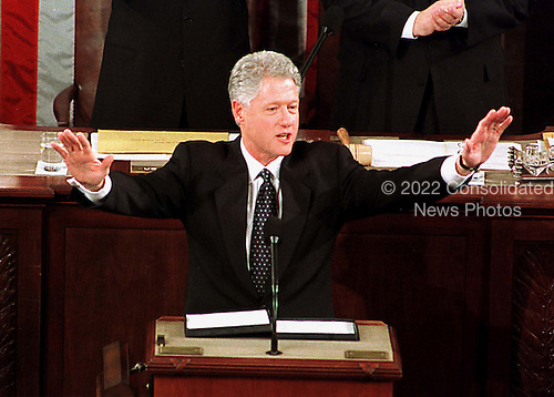 United States President Bill Clinton acknowledges the applause as he arrives in the U.S. House Chamber to deliver his State of the Union Address at the Capitol in Washington, D.C. on 19 January, 1999..Credit: Ron Sachs / CNP